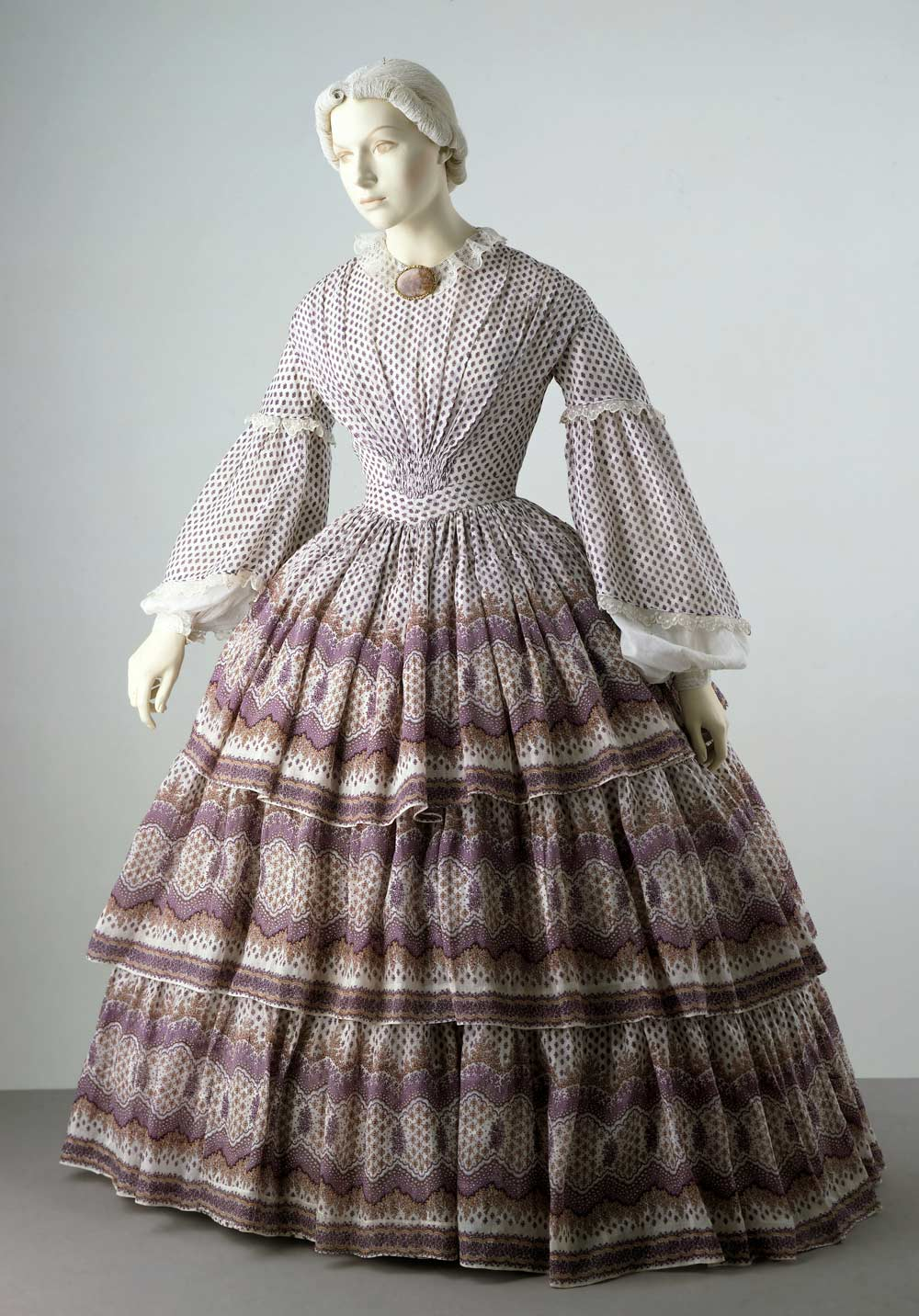 6b917e2f264c Dress with a pattern that complements the shape created by the cage  crinoline worn underneath it. Museum no. T.702-1913. © Victoria & Albert  Museum, London