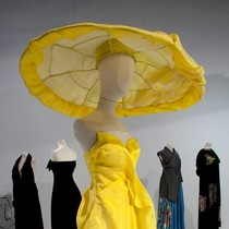 Yellow strapless silk dress and oversized coolie hat covered with draped silk, Yohji Yamamoto, Spring/Summer 1997