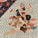 Figure 15 - The Sundial Coverlet, 1797, England. Museum no. T.102-1938. Detail of a map of England; the map is pieced over papers and embroidered.