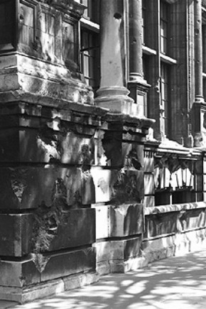 Aston Webb faade of the V&amp;A, Exhibition Road, showing bomb damage still visible today.
