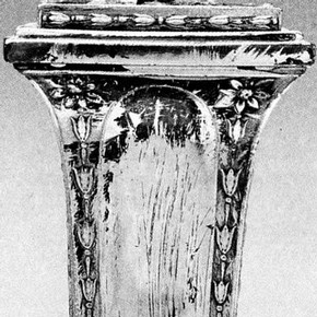 Figure 1. Detail of a Sheffield plate candlestick. Worn and degraded lacquer has caused characteristic preferential corrosion. Museum no. M.11-1912. Photography by V