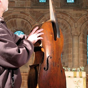 Figure 2. The author holding the Berkswell 'Cello inside the church of St. John Baptist, Berkswell, Warwickshire (Photography by Karen Lacroix)