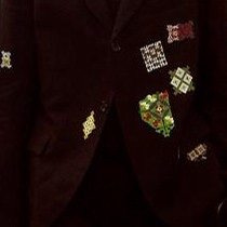 Black linen jacket with multi-coloured embroidery patches, oversized black polo shirt and cropped black linen trousers, Yohji Yamamoto, Spring/Summer 2011.  Courtesy of Monica Feudi