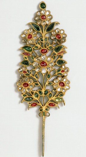 Turban ornament, India or Pakistan, early 18th century, set with rubies, emeralds, pale beryls and diamonds. Museum no. IM.240-1923