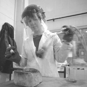 Figure 2. Lyndsey Morgan patinating bronze samples in the patination room at the RCA Sculpture School.