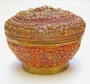 Example of the use of tamarind pulp to create a tint on the surface of gold repoussé work [Museum no. IM.49-1937]