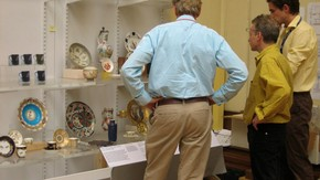 Curators discussing a 'mock up' of a display