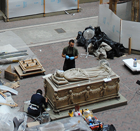 Figure 1. View of Cast Courts G46b, presently closed to the public, with conservators working in situ, Photography by Johanna Puisto.  © Victoria and Albert Museum, London