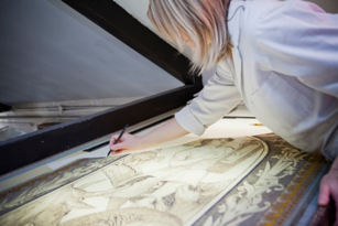Restoration work taking place on one of the William Bell Scott's stained glass panels © Victoria and Albert Museum