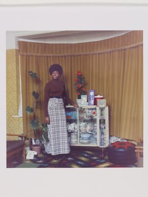 Neil Kenlock, 'Untitled (Young Jamaican lady standing in her mother's front room in Brixton Hill)', 1973. Museum no. E.212-2012. © Neil Kenlock/ Victoria and Albert Museum, London. Supported by the National Lottery through the Heritage Lottery Fund.