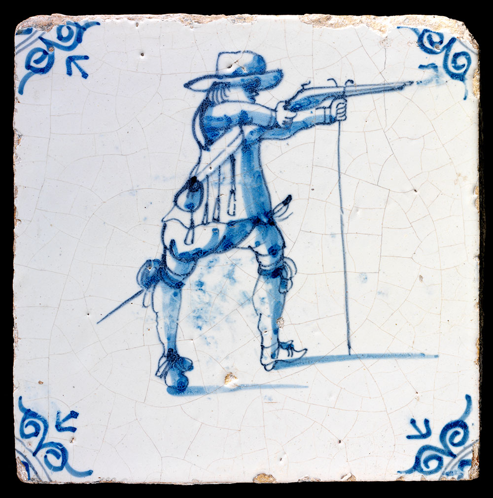 Wall tile  depicting a musketeer, 1625-50, Dutch Republic (now the Netherlands),  tin-glazed painted earthenware. Museum no. 3664A-1853, © Victoria and  Albert Museum, London