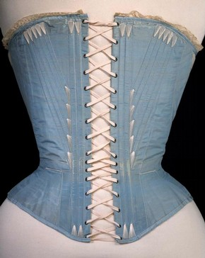 Corset (back view), blue silk stiffened with whalebone, possibly English or French, 1864. Museum no. T.169-1961