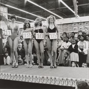 David Goldblatt, 'Saturday morning at the Pick 'n Pay Hypermarket: Miss Lovely Legs Competition', Boksburg, South Africa, 1980, gelatin-silver print. Museum no. E.81-1992, © Victoria and Albert Museum, London