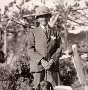 Standing portrait of Sir Aurel Stein and his dog Dash. © The British Library