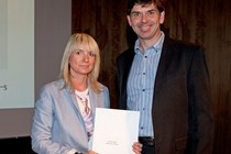 Roz Evans Flagg receiving her Benefit of Learning Prize from Simon Beer from NIACE