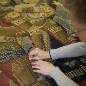 Textiles conservator working on a tapestry