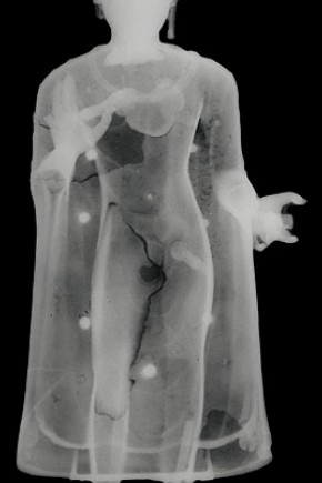 X-radiograph image of the Buddha, showing the chaplets (metal pins) that held the core
