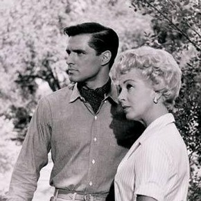 John Gavin and Lana Turner on the set of 'Imitation of Life', by Zinn Arthur, 1959. Museum no. E.58-2003, Given by John and Judith Hillelson,  Estate of Zinn Arthur