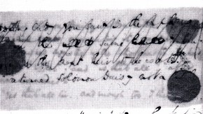 Fig.3. The manuscript verso on a light table; both cancelled and corrected text are visible