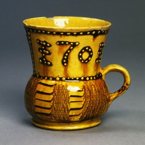 Mug, dated 1701. Probably made in Burslem, England. Museum no C.120-1938