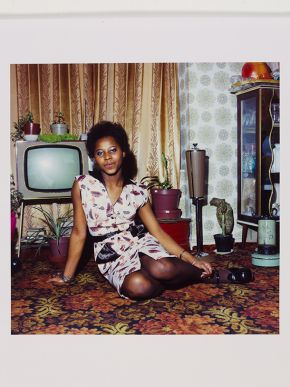 Neil Kenlock, 'Untitled [Young woman seated on the floor at home in front of her television set]', 1972. Museum no. E.306-2012. © Neil Kenlock/ Victoria and Albert Museum, London. Supported by the National Lottery through the Heritage Lottery Fund.