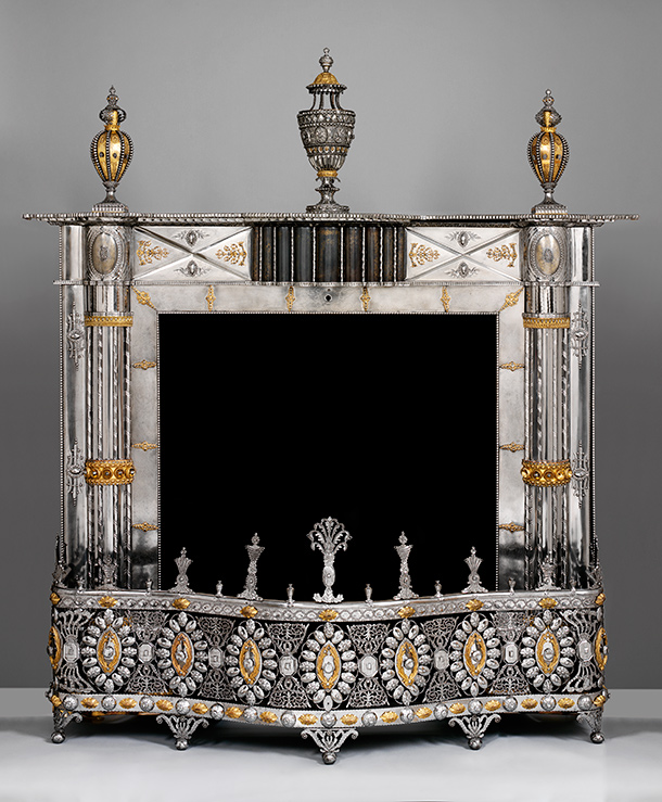Fireplace with perfume burner  and urns, made at the Russian Imperial Arms Factory, about 1800, Russia  (Tula), burnished steel with applied decoration in gilded copper alloy.  Museum no. M.49 to D-1953, © Victoria and Albert Museum, London