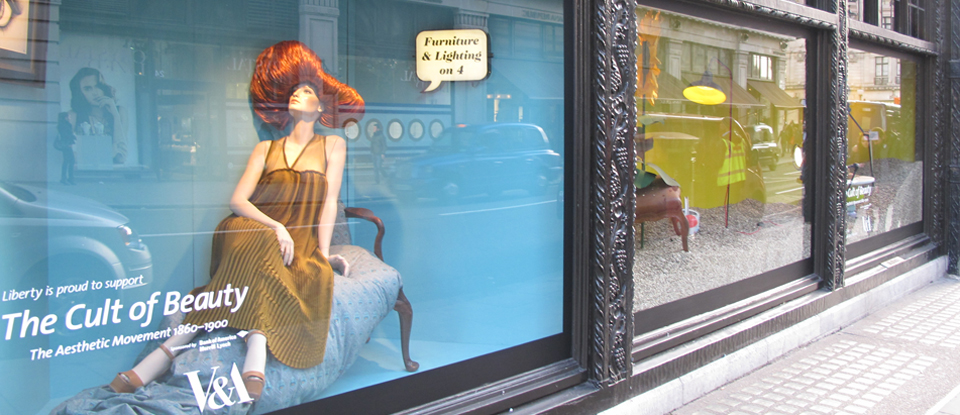 Front window of Liberty, London showing corporate sponsorship for The Cult of Beauty exhibition