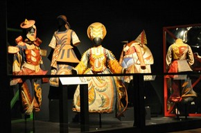 Figure 5 – Open display of five costumes from 'Chout' with a one metre high acrylic barrier and a false ceiling to protect objects. Photograph by Bhavesh Shah