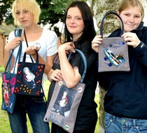 Young mums from an Action for Children project in Sheffield display bags they made for their children
