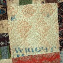 Figure 11 - Patchwork and quilted bedcover, 1810-45, England. Museum no. T.17-1924. Detail of printer's mark on cotton patch.