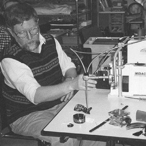 Figure 1. Scott Williams at work using the portable FTIR spectrometer in one of the studios of the Costume Institute. Photography by Silvia Valussi.
