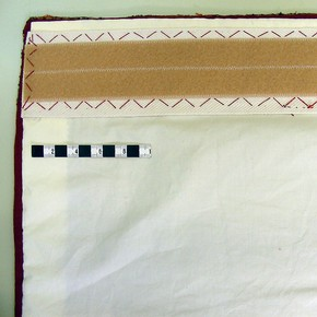 A conserved carpet with cotton lining and Velcro attached ready for hanging.
