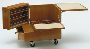 Kozma Drinks Trolley (open view), designed by Zsuzsa Kozma (1913 - ), Budapest, Hungary, about 1938-9, walnut, chromed metal, linoleum, later rubber wheels. Museum no. W.21-1997