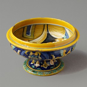 Tin-glazed earthenware broth-bowl from an accouchement set, with painted birth scene by Francesco Xanto, Urbino, Italy, about 1530. Museum no. C.2241-1910