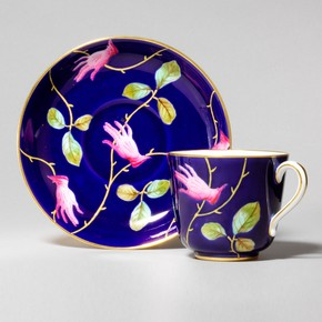 Bone china cup and saucer, decorated with design attributed to Salvador Dali, by Royal Crown Derby, England, UK, 1938-9. Museum no. C.9:1&2-2006