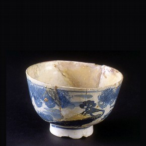 A poorly repaired English tin glazed earthenware bowl, late 17th to mid 18th century.