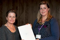 Susan Early receiving her Museum of Childhood prize from curator, Sarah Louise Wood