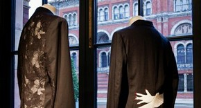 Black suit jacket with back made from lace, white shirt and black trousers