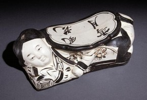 Figure 4 - Ceramic pillow, China, Jin dynasty, 1115-1234, cizhou ware. © The Trustees of the British Museum