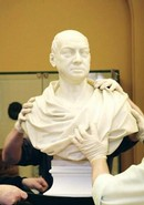 Installing a bust in the sculpture gallery