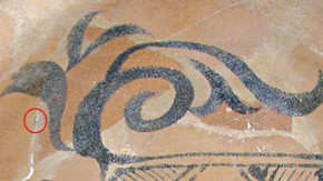 Figure 3. Detail from bowl during cleaning showing the incorrectly painted blue design, the circle indicates the small area of the original blue decoration that emerged after removing the old restoration material (Photography by Hanneke Ramakers)