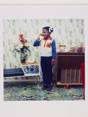 Neil Kenlock, 'Untitled [A young girl speaking on her parents' telephone in South London]', 1973. Museum no. E.214-2012. © Neil Kenlock/ Victoria and Albert Museum, London. Supported by the National Lottery through the Heritage Lottery Fund.