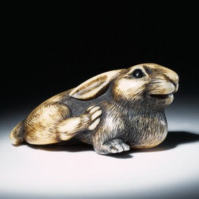 Carved ivory netsuke in the shape of a rabbit, Scu, Japan, 19th century. Museum no. A.62-1915
