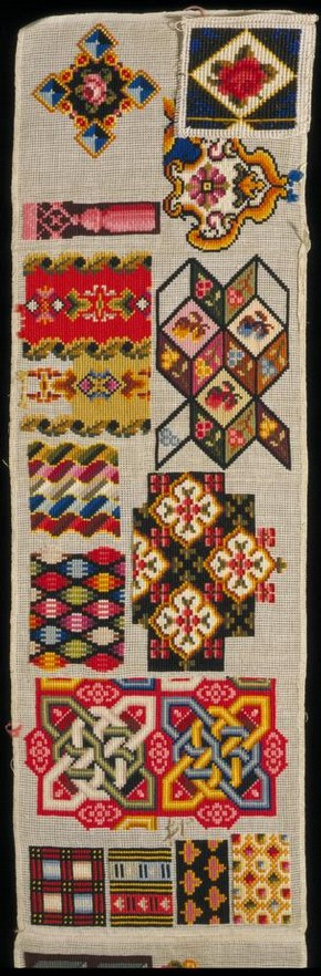 Sampler, unknown, mid 19th century, cotton, embroidered with wool and silk in cross stitch, 133.4 cm x 21.5 cm, England, given by Mrs D. McGregor. Museum no. T.240-1967