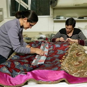 Textile conservators working on a costume for Diaghilev's opera Boris Godunov