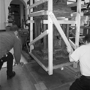 Figure 2. Braced-off model being lowered onto corner wheels, after removal of upper section. Photography by Claira Partington.