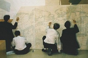 Students drawing the outline of their mural
