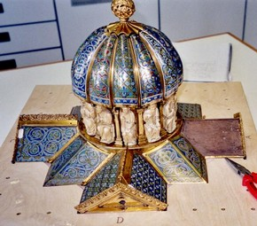 Two enamel plaques removed to reveal wooden core of tabernacle