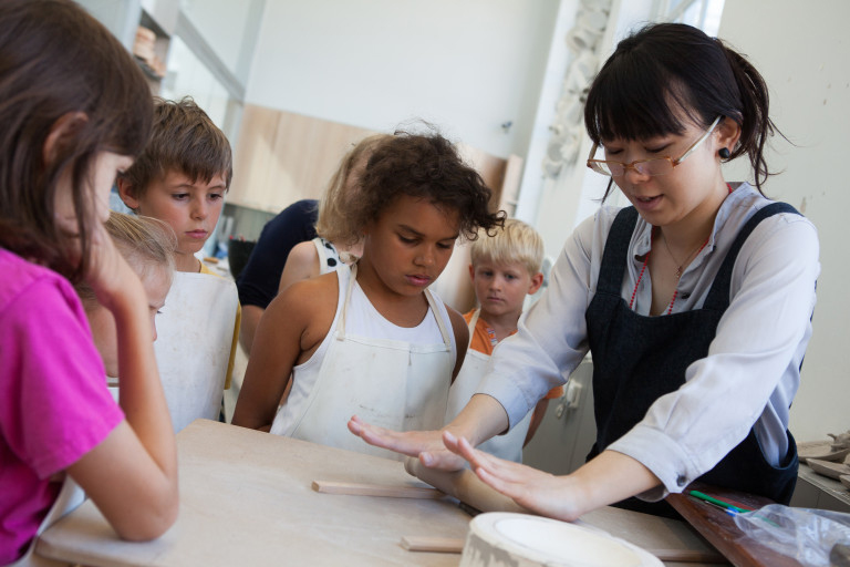 Japanese Ceramicist in Residence, Keiko Matsumoto, leading a families workshop in her studio. © Victoria and Albert Museum, London
