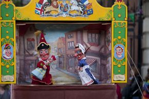 Judy gives Mr Punch the baby to look after. Geoff Felix's Punch and Judy show, May Fayre, Covent Garden, May 2012. © Victoria and Albert Museum, London.